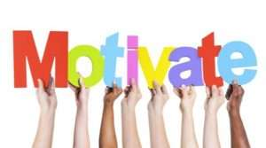 Image of hands holding up the word Motivate on page Find out what motivates you